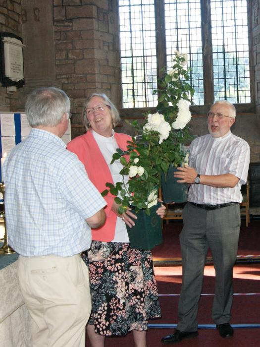 Revd Heather and Revd Chris receive their rose plants