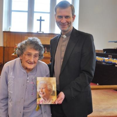 Joyce Morse with Revd Dr James Tebbutt and her 100th Birthday Telegram from the Queen
